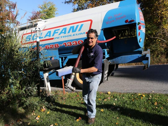 Mike Rosa of Sclafani Oil makes a delivery of home