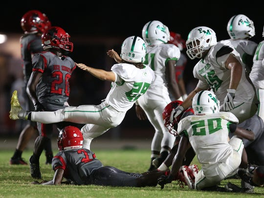 North Fort Myers blocked a field goal and a punt in the Red Knights' 34-17 win over Fort Myers on Sept. 1.