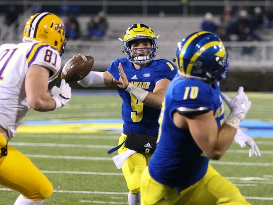 Delaware quarterback J.P. Caruso throws a pass taken the goal line by Kyle Yocum in the fourth quarter of the Blue Hens' 22-3 win at Delaware Stadium Saturday.