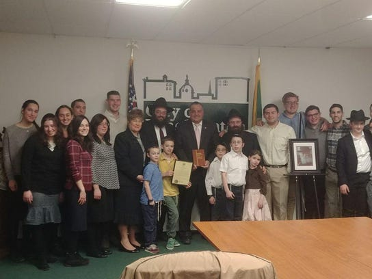 A delegation from Chabad of Binghamton meets with Mayor