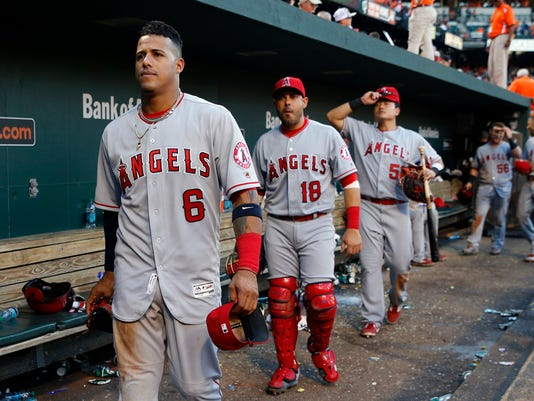 Los Angeles Angels third baseman Yunel Escobar (6) walks out of the dugout after a baseball game against the Baltimore Orioles in Baltimore, Saturday, July 9, 2016. (AP Photo/Patrick Semansky)