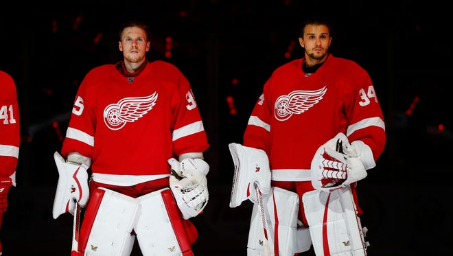 Detroit Red Wings goalies Jimmy Howard, left, and Petr Mrazek are introduced before a game Oct. 9, 2015.