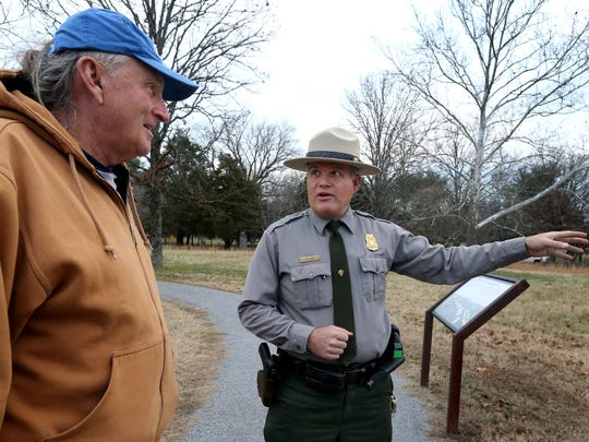 Jim Lewis, right, a park ranger at Stones River National Battlefield, Dec. 19 talks with Michael Kusmak, a visitor to the park from New Mexico, about where Hell's Half Acre is located at the battlefield.