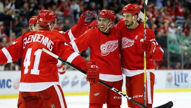 Wings forward Andreas Athanasiou, second from right, celebrates a goal against the Hurricanes in Detroit.