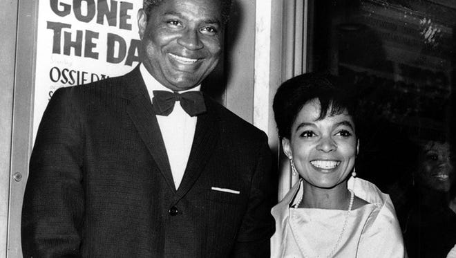 Ossie Davis, left, and Ruby Dee pose at the Trans-Lux East Theater in 1963.