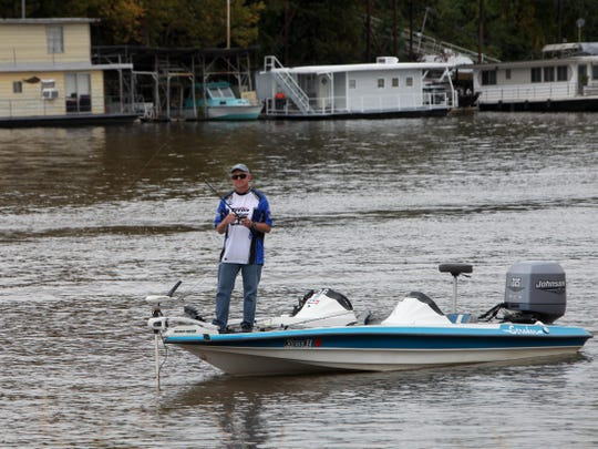 An angler in the 2015 Bassmaster Classic fishes in the Ouachita River near Forsythe Point.