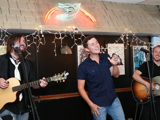 Scotty McCreery performs for campers at the ACM Lifting