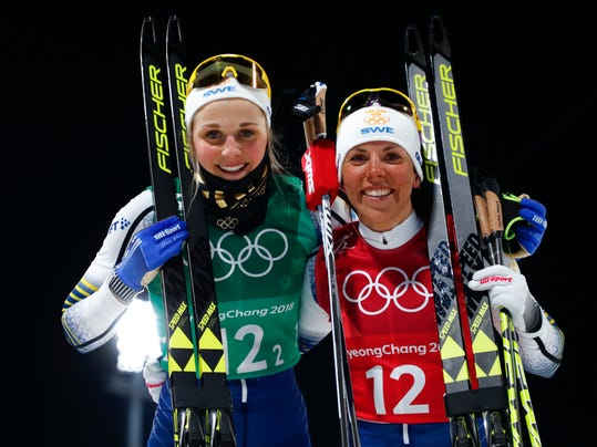 United States' Jessica Diggins, left, and Kikkan Randall pose after winning the gold medal in the women's team sprint freestyle cross-country skiing final at the 2018 Winter Olympics in Pyeongchang, South Korea, Wednesday, Feb. 21, 2018. (AP Photo/Matthias Schrader)