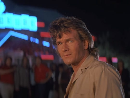 "Patrick Swayze plays a martial artist bouncer in ""Road House."""