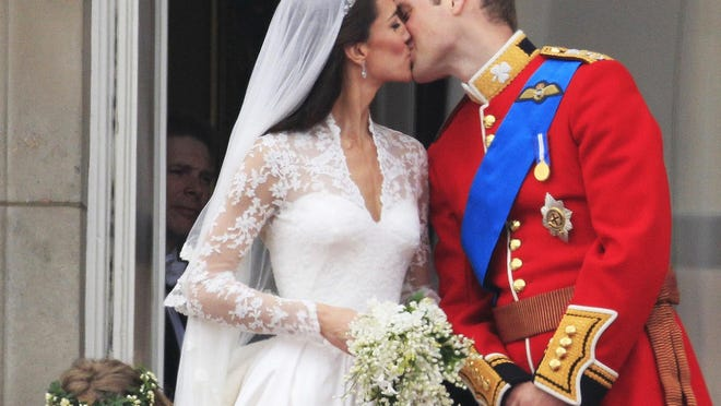 Britain's Prince William kisses his wife, Kate, Duchess of Cambridge, after the royal wedding in London in 2011.