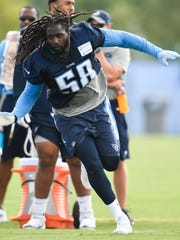 Titans outside linebacker Erik Walden (58) runs through