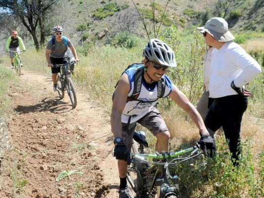JUAN CARLO/THE STAR Cyclists pedal on the Backbone Trail at Point Mugu State Park after the Mountain Bike Unit volunteers and Steve Messer, president of the Concerned Off-Road Bicyclists Association, did some work for Santa Monica Mountains Trail Days.