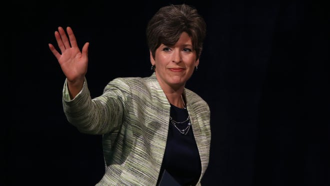 Republican Senator candidate Joni Ernst waves to supporters during the 2014 Iowa Republican Convention at Hy-Vee Hall in Des Moines, Iowa, on Saturday, June 15, 2014.