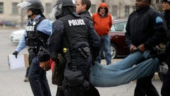 A protester is arrested outside St. Louis City Hall
