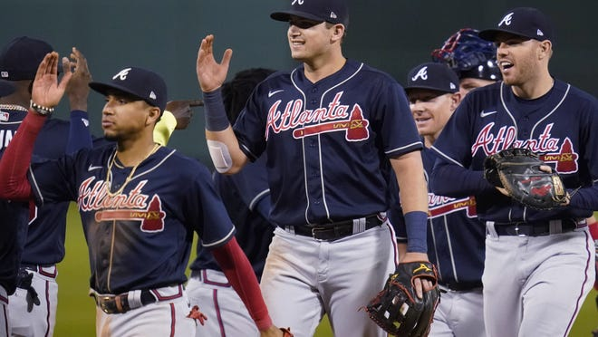 Atlanta Braves' Austin Riley, center, celebrates with teammates after defeating the Boston Red Sox in a baseball game Monday, Aug. 31, 2020, in Boston.