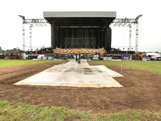 Crews assemble the stage on Friday, July 3, 2015 as