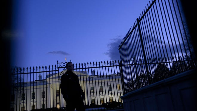 A member of the Secret Service's uniformed division stands by a fence in front of the White House  on Nov. 20.