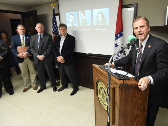 As investigators look on Monday afternoon, Prosecuting