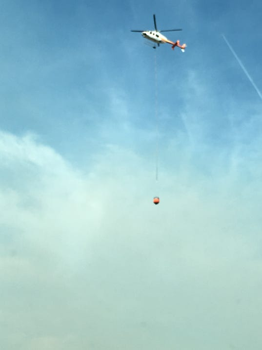 636548073748845347-Helicopter-responding-to-Rozell-Fire.JPG