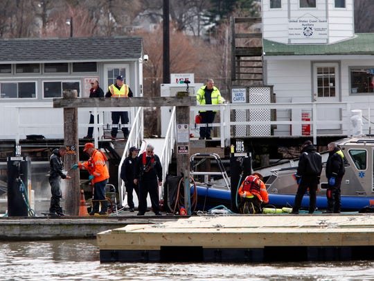Divers return after trying to recover the third victim from the March 12 tugboat crash on March 15 in Tarrytown. The victim will not be recovered until the vessel is salvaged.