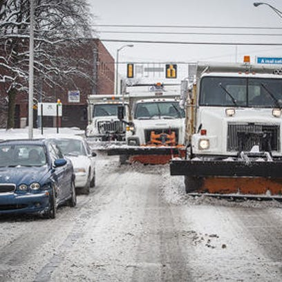 Snow plows move down Muncie streets.