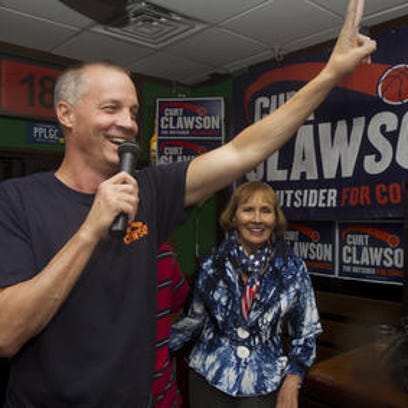 U.S. Rep. Curt Clawson accompanied by his mother, Cherie,