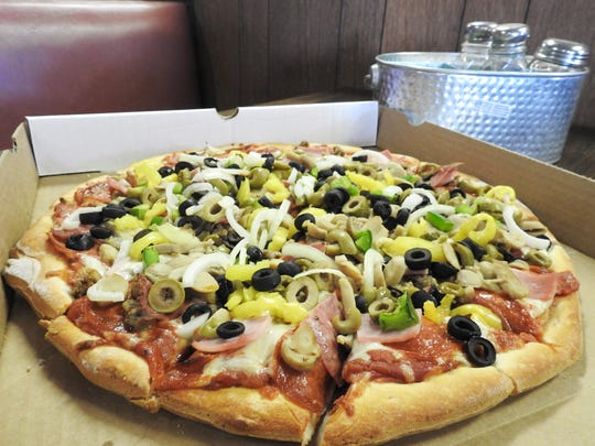 The all-the-way pizza at Fallsburg Pizza Your Frazeysburg Connection has 11 toppings and is made with homemade dough and pizza sauce.