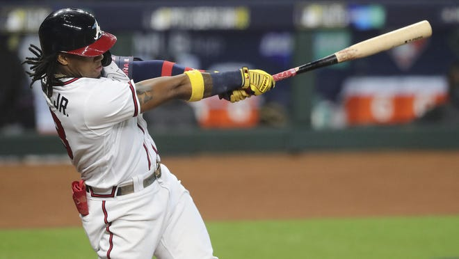 Atlanta Braves' Ronald Acuna hits a solo homer off Miami Marlins starting pitcher Sandy Alcantara during the first inning of Game 1 of a baseball NL Division Series on Tuesday, Oct. 6, 2020, in Houston.