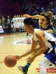 Carlsbad's Ralph Cueto tries to beat Rio Rancho's Jeremy Snider to the ball in the first quarter Saturday.