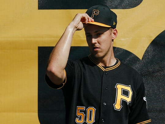 FILE - In this Feb. 16, 2018, file photo, Pittsburgh Pirates starting pitcher Jameson Taillon stands in the bullpen during baseball spring training, in Bradenton, Fla. Maybe the best thing about Taillon's 2017 is that it's over. The Pirates pitcher dealt with a brief cancer battle and other health issues during a rocky first full season in the majors. (AP Photo/John Minchillo, File)