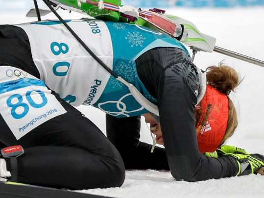 Laura Dahlmeier, of Germany, collapse after completing the women's 15-kilometer individual biathlon at the 2018 Winter Olympics in Pyeongchang, South Korea, Thursday, Feb. 15, 2018. (AP Photo/Andrew Medichini)