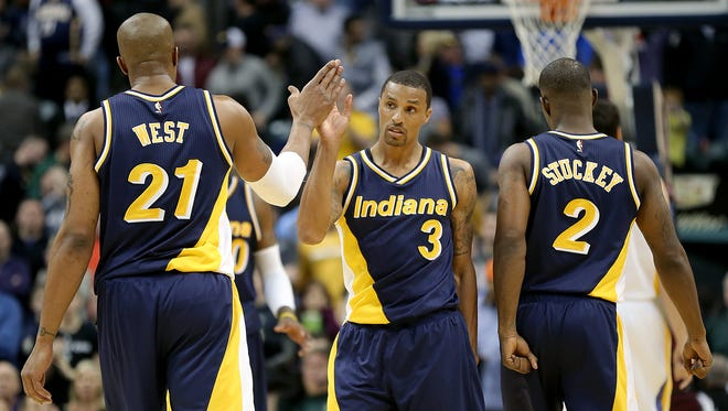 Indiana Pacers guard George Hill (3) high-fives  David West in the second half of their game Sunday, February 22, 2015, evening at Bankers Life Fieldhouse. The Pacers defeated the Warriors 104-98.