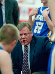 Ontario coach Joe Balogh talks during a timeout during a game last season. Balogh reached 500 wins as a head boys basketball coach, with all 500 coming at Ontario.