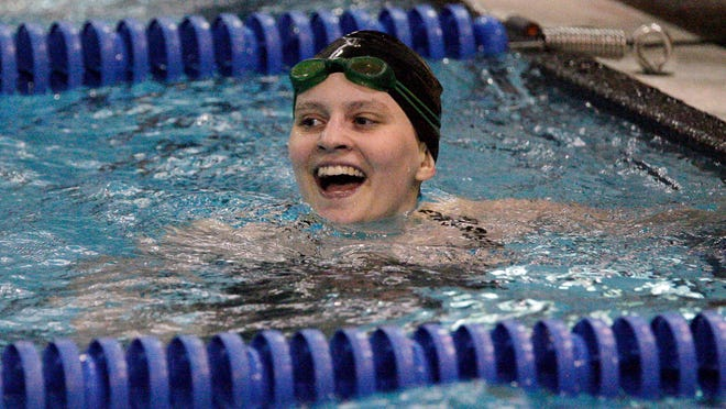 Green Bay United's Rosalyn Stoa reacts to her time in the 200 yard freestyle Saturday November 1, 2014 at Sheboygan North.