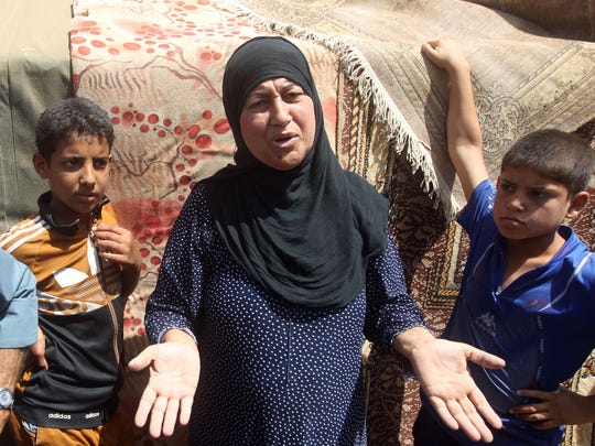 Iraqi families who fled the city of Ramadi after it