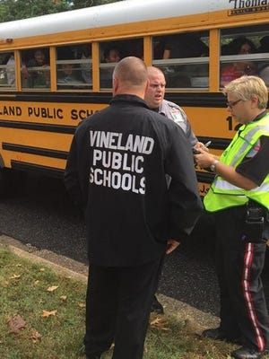 Students look on from a bus involved in a collision on Chestnut Avenue in Vineland on Thursday.
