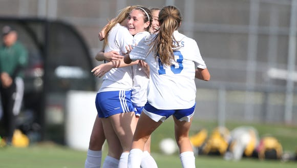 Pearl River's Kate McNally (7) celebrates with her