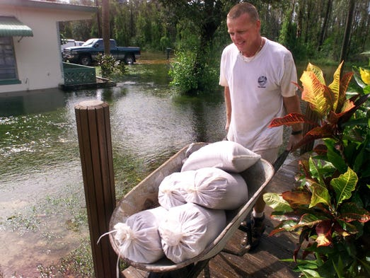 In this September 2001 photo, Bob Etnire wheels sandbags