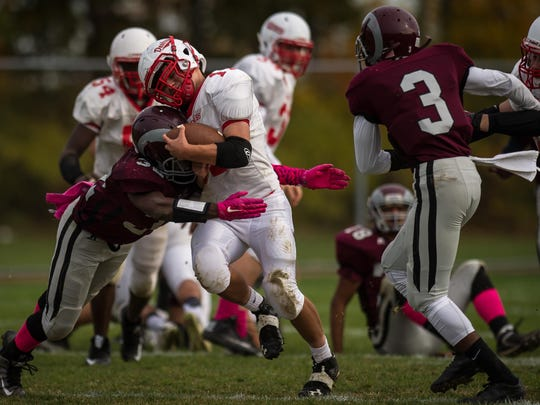 South River's Khaliyl Everett delivers a hit to Dunellen's Connor McCrimmon in the second quarter of their game on Sat. Oct. 31, 2015 in South River. Photo by Jeff Granit