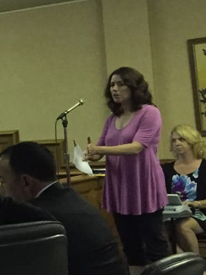 Monica Manning, who opposes the Village 35 project, asks questions during a 2016 hearing on the proposed shopping center in Middletown.