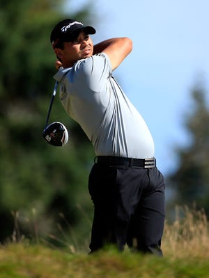 Jason Day of Australia hits his tee shot on the 14th hole during the third round of the 115th U.S. Open Championship at Chambers Bay on June 20, 2015 in University Place, Wash.