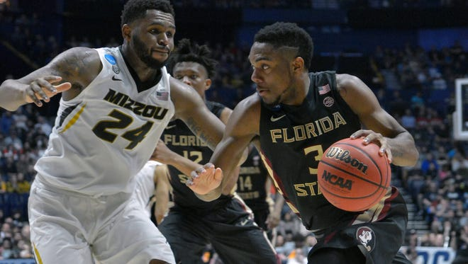 Mar 16, 2018; Nashville, TN, USA; Florida State Seminoles guard Trent Forrest (3) drives against Missouri Tigers forward Kevin Puryear (24) during the first half in the first round of the 2018 NCAA Tournament at Bridgestone Arena. Mandatory Credit: Jim Brown-USA TODAY Sports