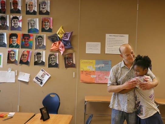 Spero Michailidis, a youth educator with M.K. Gandhi