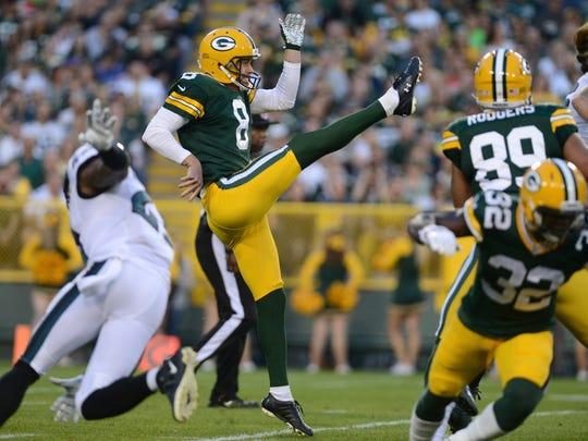 Green Bay Packers punter Tim Masthay (8) follows through
