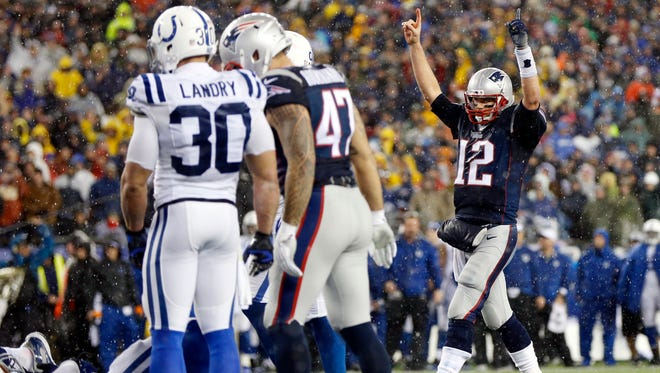 New England Patriots quarterback Tom Brady (12) celebrates after a touchdown during the fourth quarter against the Indianapolis Colts in the AFC Championship Game at Gillette Stadium in Foxborough, Mass., on Jan. 18.