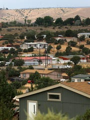 Homes dot the hillside along Road 390 Monday in Crouch Mesa. The company that provides water to some of its residents has not been able to fix a problem that has required they boil drinking water.