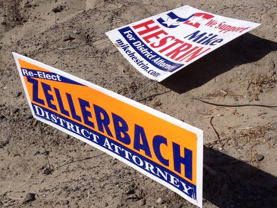 In this April 24 photo, campaign signs for Mike Hestrin and Paul Zellerbach are seen  at Jefferson Street and Indio Boulevard.