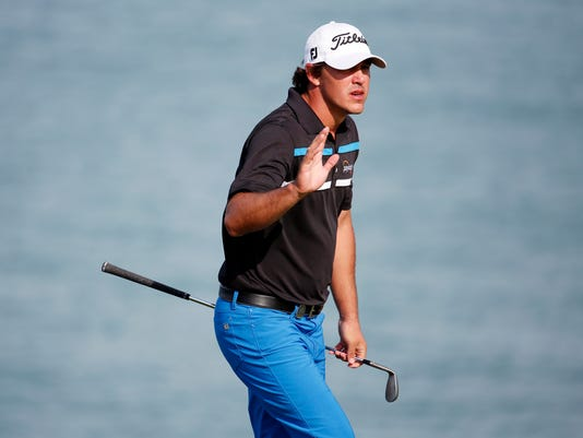 FILE - In this Aug. 13, 2015, file photo, Brooks Koepka reacts after chipping in for birdie on the 13th hole during the first round of the PGA Championship golf tournament at Whistling Straits in Haven, Wis. Koepka is the lone American rookie on the Ryder Cup team who already has felt the sting of losing twice. (AP Photo/Julio Cortez, File)
