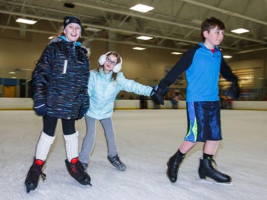 Members of the LaPorte family of Pewaukee (from left) Lydia, Dahlia and Noah public skating at Naga-Waukee Ice Arena.