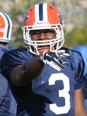 UTEP running back Treyvon Hughes, 3, communicates with another offensive teammate before a play Friday at Glory Field